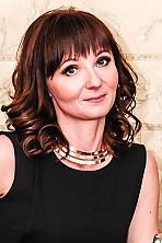 Ukrainian girl Oksana,40 years old with grey eyes and dark brown hair.