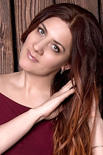 Ukrainian girl Alyona,39 years old with green eyes and red hair.
