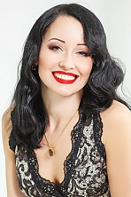 Ukrainian girl Svetlana,40 years old with green eyes and dark brown hair.