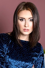 Russian girl Julia,22 years old with hazel eyes and dark brown hair.