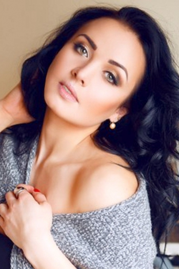 Ukrainian girl Marina,27 years old with green eyes and dark brown hair.