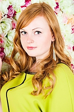 Russian girl Julia,27 years old with green eyes and red hair.