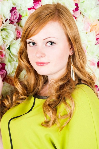Russian girl Julia,28 years old with green eyes and red hair.