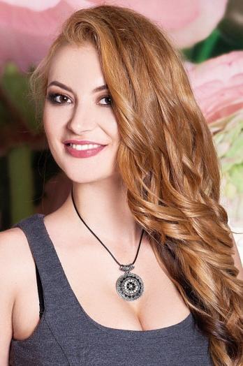 Ukrainian girl Oksana,29 years old with brown eyes and dark brown hair.