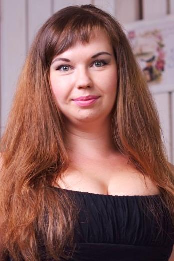 Ukrainian girl Margarita,30 years old with grey eyes and dark brown hair.