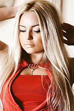 Ukrainian girl Evgeniya,30 years old with brown eyes and blonde hair.