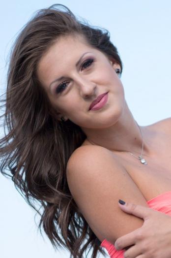 Ukrainian girl Anastasia,21 years old with blue eyes and dark brown hair.
