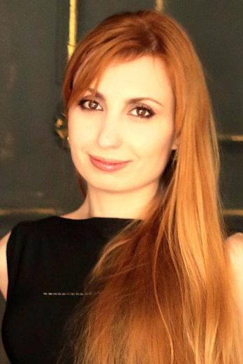 Ukrainian girl Tatiana,34 years old with brown eyes and red hair.