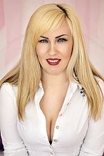Ukrainian girl Janna,33 years old with blue eyes and blonde hair.