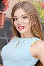Ukrainian girl Alena,28 years old with blue eyes and light brown hair.