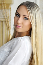 Ukrainian girl Valentina,19 years old with grey eyes and blonde hair.