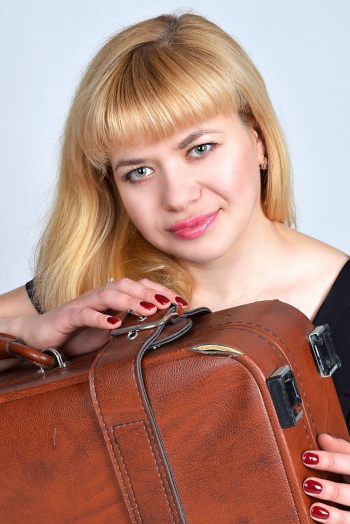 Ukrainian girl Elena,34 years old with green eyes and blonde hair.