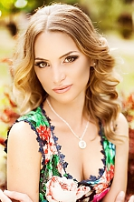 Ukrainian girl Vlada,31 years old with brown eyes and dark brown hair.
