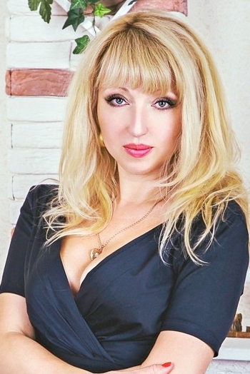 Ukrainian girl Victoria,42 years old with grey eyes and blonde hair.