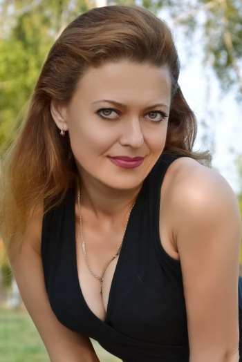 Ukrainian girl Anzhelika,44 years old with green eyes and dark brown hair.