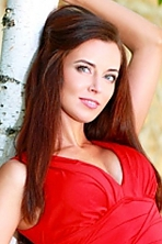 Ukrainian girl Lyudmila,35 years old with green eyes and light brown hair.