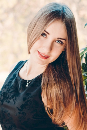 Ukrainian girl Tatiana,22 years old with blue eyes and light brown hair.