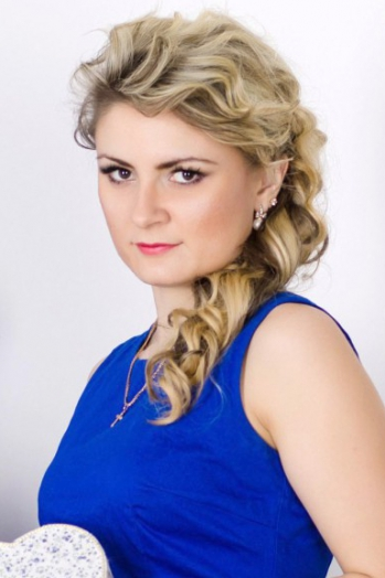 Ukrainian girl Alla,27 years old with brown eyes and blonde hair.