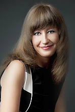 Ukrainian girl Nataliya,45 years old with green eyes and light brown hair.
