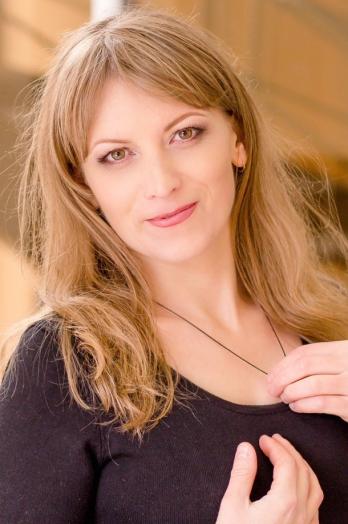 Ukrainian girl Svetlana,32 years old with brown eyes and light brown hair.