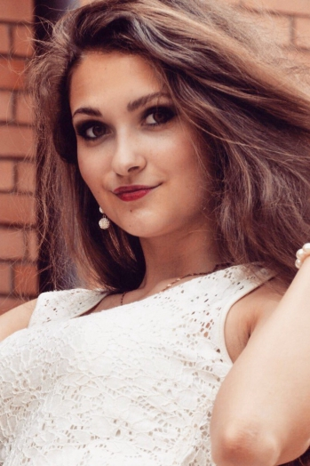 Ukrainian girl Julia,20 years old with green eyes and light brown hair.