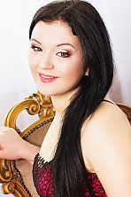 Ukrainian girl Alena,28 years old with brown eyes and black hair.