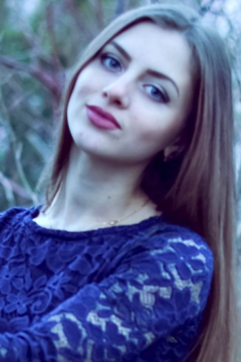 Ukrainian girl Olga,20 years old with blue eyes and light brown hair.