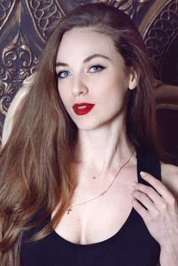 Ukrainian girl Anastasia,29 years old with green eyes and light brown hair.