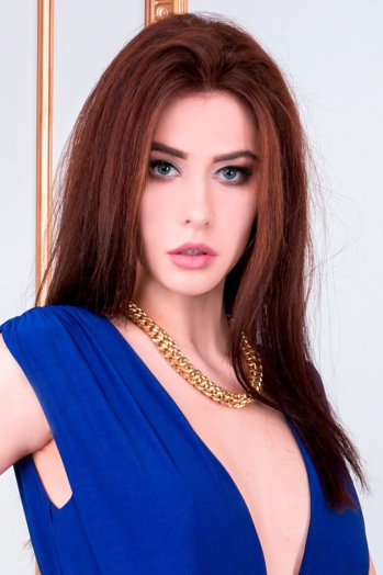 Ukrainian girl Anna,23 years old with blue eyes and black hair.