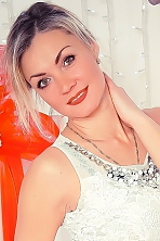 Ukrainian girl Elena,39 years old with brown eyes and blonde hair.