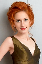 Ukrainian girl Svetlana,21 years old with grey eyes and red hair.