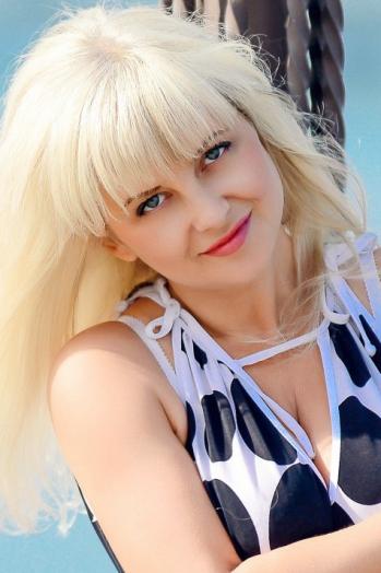 Ukrainian girl Svetlana,45 years old with blue eyes and blonde hair.