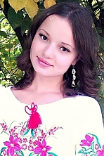 Ukrainian girl Miroslava,20 years old with brown eyes and dark brown hair.