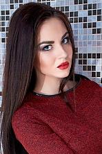 Ukrainian girl Anastasia,22 years old with brown eyes and black hair.