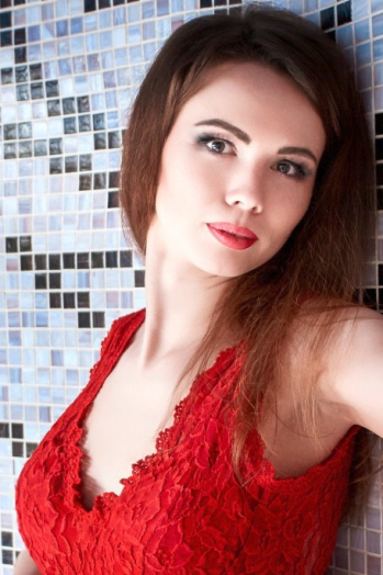 Ukrainian girl Margarita,37 years old with brown eyes and auburn hair.