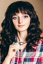 girl Nataliia, years old with  eyes and  hair.