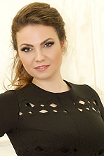 Ukrainian girl Nataliya,33 years old with grey eyes and light brown hair.