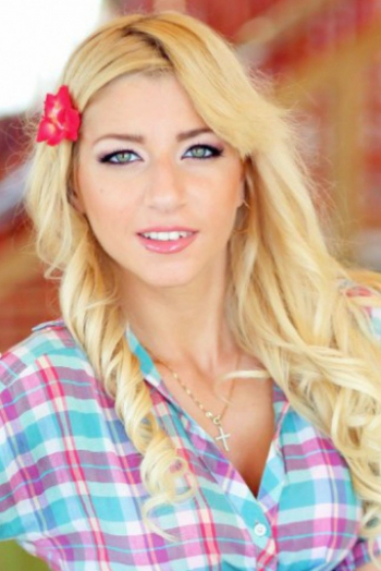 Ukrainian girl Angela,22 years old with blue eyes and blonde hair.