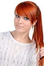 Ukrainian girl Anna,18 years old with blue eyes and red hair.
