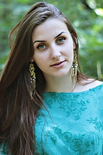 Ukrainian girl Tamara,20 years old with green eyes and dark brown hair.