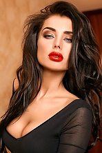 Ukrainian girl Anna,27 years old with green eyes and black hair.