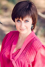 Ukrainian girl Evgeniya,30 years old with grey eyes and dark brown hair.