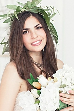 Ukrainian girl Ekaterina,20 years old with brown eyes and dark brown hair.