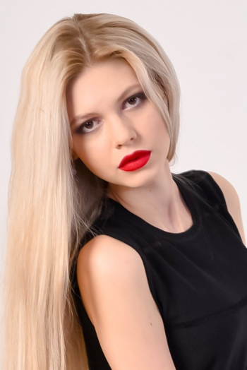 Ukrainian girl Eugenia ,24 years old with brown eyes and blonde hair.