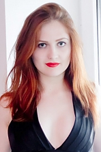 Ukrainian girl Aliona,22 years old with green eyes and red hair.