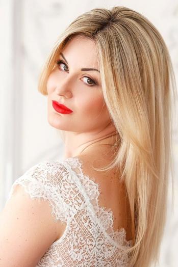 Ukrainian girl Olga,39 years old with brown eyes and blonde hair.