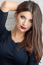 Ukrainian girl Katerina,26 years old with blue eyes and dark brown hair.