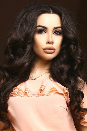 Ukrainian girl Lyana,20 years old with blue eyes and black hair.