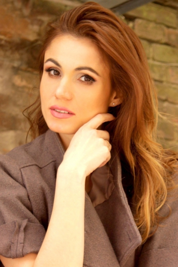 Ukrainian girl Natalya,34 years old with brown eyes and dark brown hair.