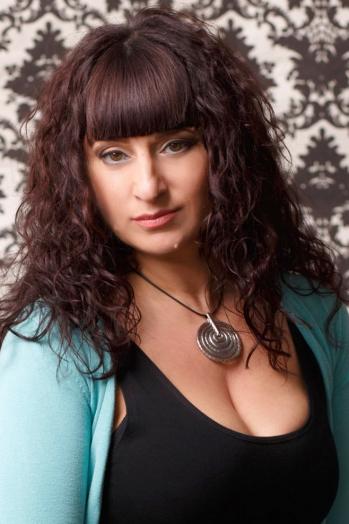 Ukrainian girl Larisa,46 years old with green eyes and dark brown hair.